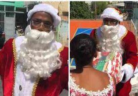 Nego do Borel se veste de Papai Noel e distribui presentes em comunidade carente