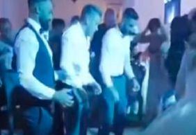Vídeo | Noivo fratura a coluna após convidados o jogarem pra cima