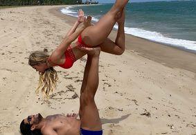 Hulk e noiva fazem poses arriscadas em praia